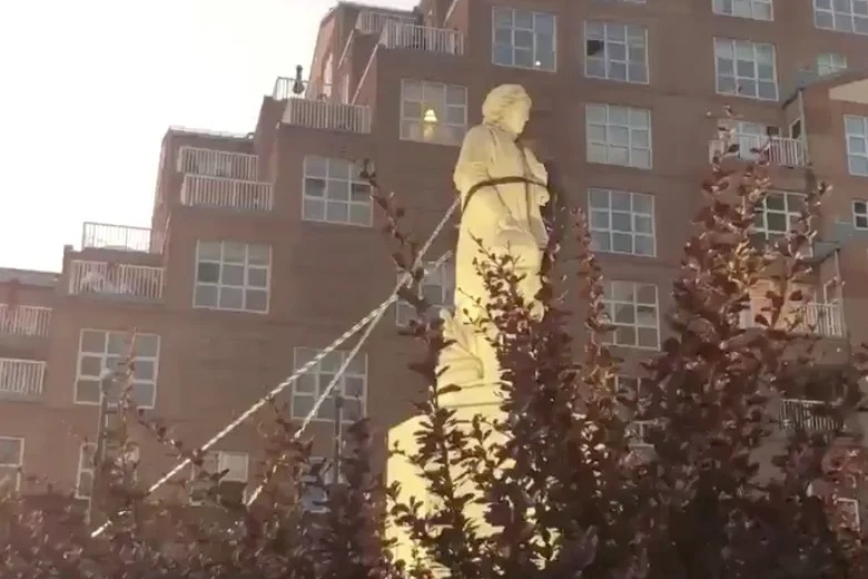 Protesters pull down the statue of Christopher Columbus